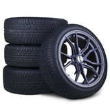 Four racing tires isolated Stock Photography