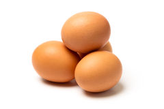 Four eggs  on white background Stock Photos