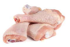 Four raw chicken drumsticks isolated on white background Stock Photo