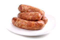 Four raw sausages. Isolated over white background Royalty Free Stock Images