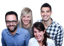Four real people. Group of four real, everyday people posing with a big smile Royalty Free Stock Photos