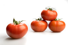 Four realistic red tomatoes piled up isolated in white background Stock Image