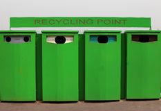 Four Recycling Bins For Glass and Cans. Green Recycling Containers For Clear, Green, Brown Glass and Cans Stock Photos