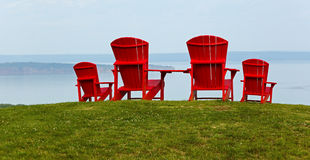 Four Red Adirondack Chairs Stock Photography