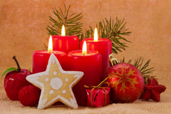 Four red advent  candles. Stock Photo