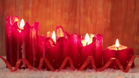 Four red advent candles with white snow. stock footage