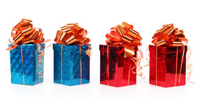 Four red and blue beautiful gift boxes isolated Royalty Free Stock Photos