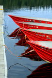 Four Red Boats. 4 red boats tied up at a dock Royalty Free Stock Images
