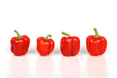 Four red bulgarian peppers Royalty Free Stock Photo