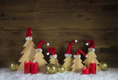 Four red burning advent candles with carved christmas trees on w Royalty Free Stock Images
