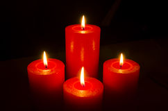 Four red burning candles for Advent. Christmas Stock Photo