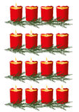 Four red candles. Burning on white background Royalty Free Stock Photography