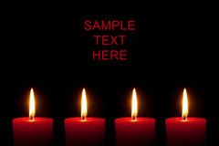 Four red candles, black background Stock Photography