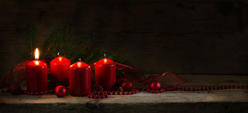 Four red candles, one of them burning on the first advent, chris Royalty Free Stock Images