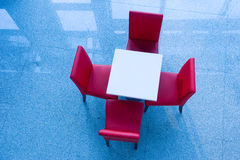Four Red Chairs At A Table Royalty Free Stock Image