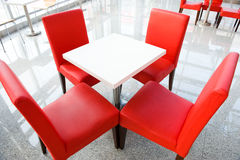 Four Red Chairs At A Table Royalty Free Stock Photography