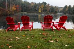 Four red chairs with autumn Stock Image