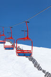 Four red chairs of ski lift Stock Image