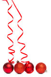 Four red christmas ball decorations Stock Images