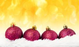 Four red Christmas ball on fur Stock Photo