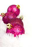 Four red Christmas ball on fur Royalty Free Stock Image