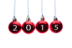 Four red christmas balls with numbers of old year 2015 Royalty Free Stock Photo