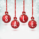 Four red Christmas balls with ribbons and bows. Four red Christmas balls with ribbons and bows,on winter background with snow and snowflakes. Sale poster Royalty Free Stock Photography