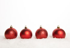 Four red christmas balls Royalty Free Stock Photo