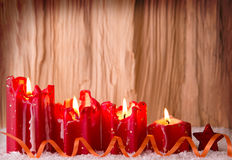 Four red christmas candle for advent. Four Candle For Advent. Romantic Atmosphere With Candlelight And Snowflakes. Wooden background Stock Photos