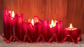 Four red christmas candle for advent. stock video footage