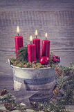 Four red christmas candles Stock Photo