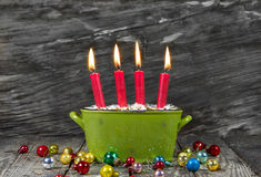Four red christmas candles - traditonel in green and red - decor Stock Images