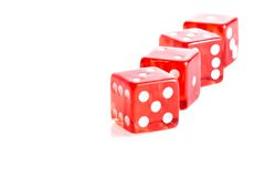Four red dice in a row Royalty Free Stock Photos