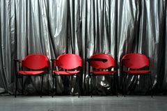 Four red empty chairs Royalty Free Stock Images