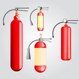 Four red fire extinguisher Royalty Free Stock Photography