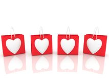 Four red hearts on white. In backgrounds Stock Photo