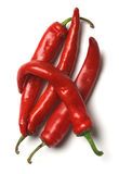 Four red hot chilli peppers Stock Photo