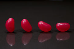 Four red jellybeans Stock Image