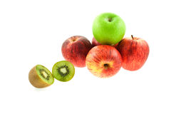 Four red, one green apples and kiwifruit Royalty Free Stock Image