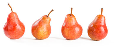 Four red pears. On white Royalty Free Stock Images