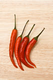 Four Red Peppers Royalty Free Stock Photos