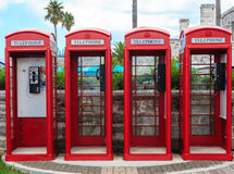 Four Red Phone Booths Stock Images