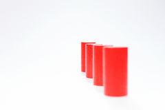 Four red round wooden building blocks in a row Royalty Free Stock Photography