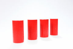 Four red round wooden building blocks in a row Royalty Free Stock Image