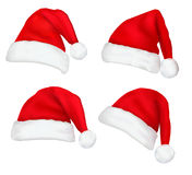 Four red santa hats. Stock Photo