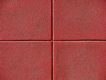 Four Red Squares. On a concrete wall, powerpoint background and copy space Royalty Free Stock Photo