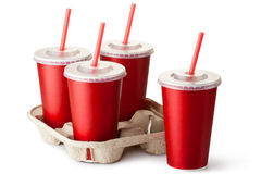 Four red takeout cups with a cup holder Stock Photos