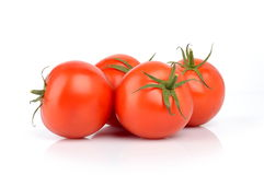 Four red tomatoes  on white. Four red delicious tomatoes  on white Royalty Free Stock Image