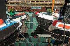 Four reflected boats moored Royalty Free Stock Photos