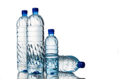 Four refreshing mineral water in plastic bottle in white backgro Stock Photography